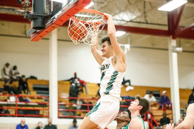 Zionsville Community High School's Nathan Childress (24), hits a big dunk during a game between Zionsville Community High School, and Valparaiso High School, in the 4th Annual Manuel Extravaganza Showcase held at Emmerich Manuel High School in Indianapolis on Saturday, Dec. 22, 2018.