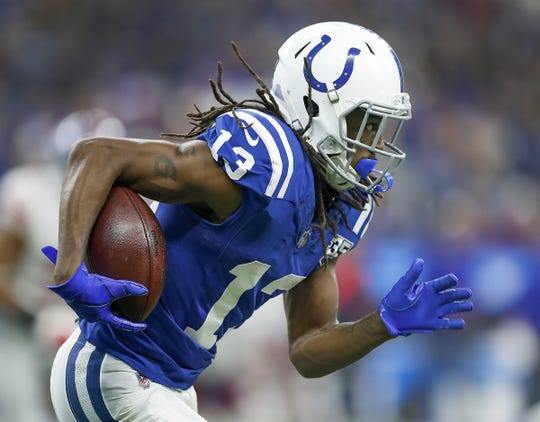 Indianapolis Colts wide receiver T.Y. Hilton (13) runs up field following a catch in the first half of their game at Lucas Oil Stadium on Sunday, Dec. 23, 2018.