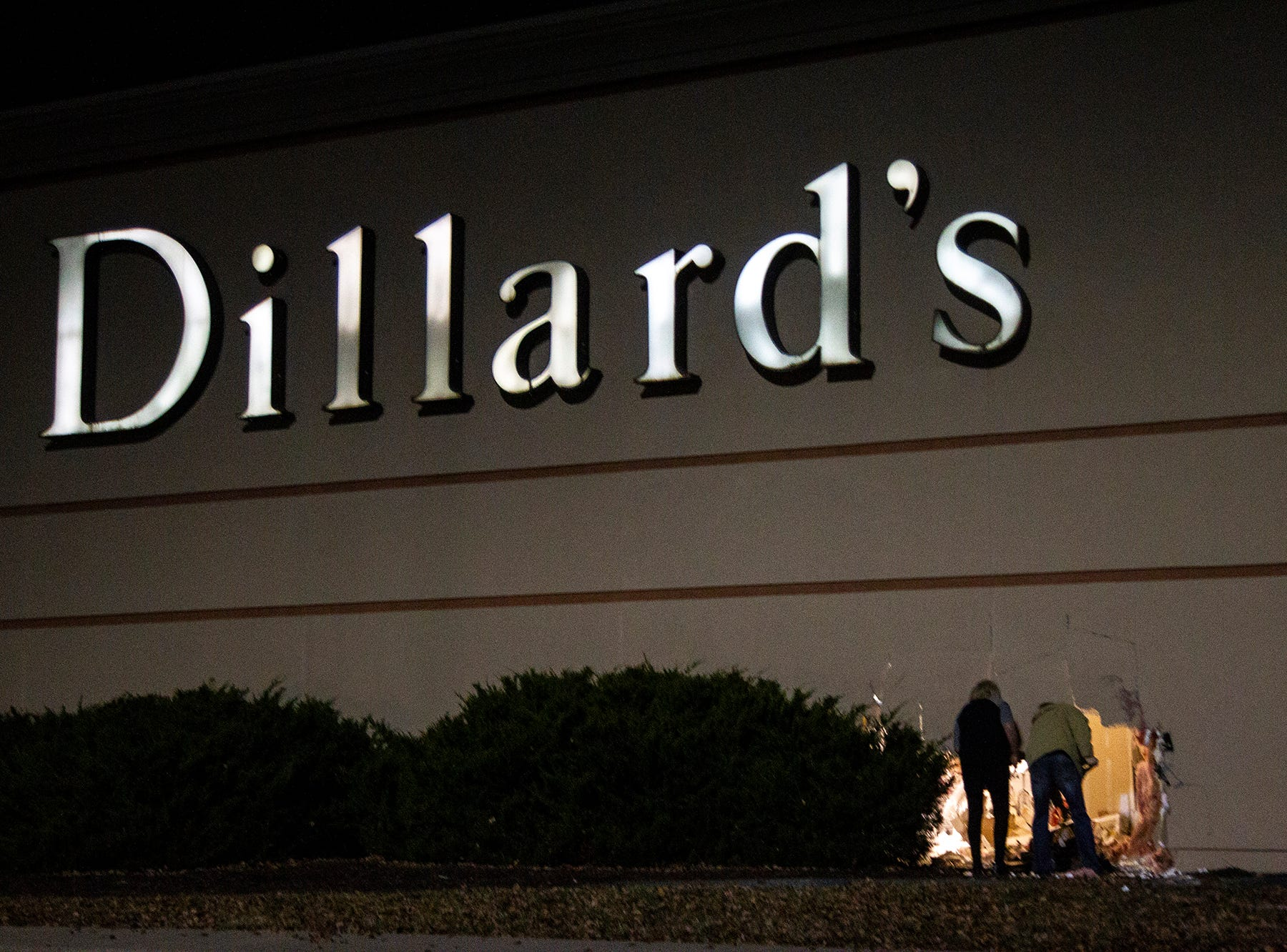Mall security respond to a scene where a vehicle drove into the side of the building on Saturday, Dec. 22, 2018, outside Dillard's department store at the Coral Ridge Mall in Coralville.