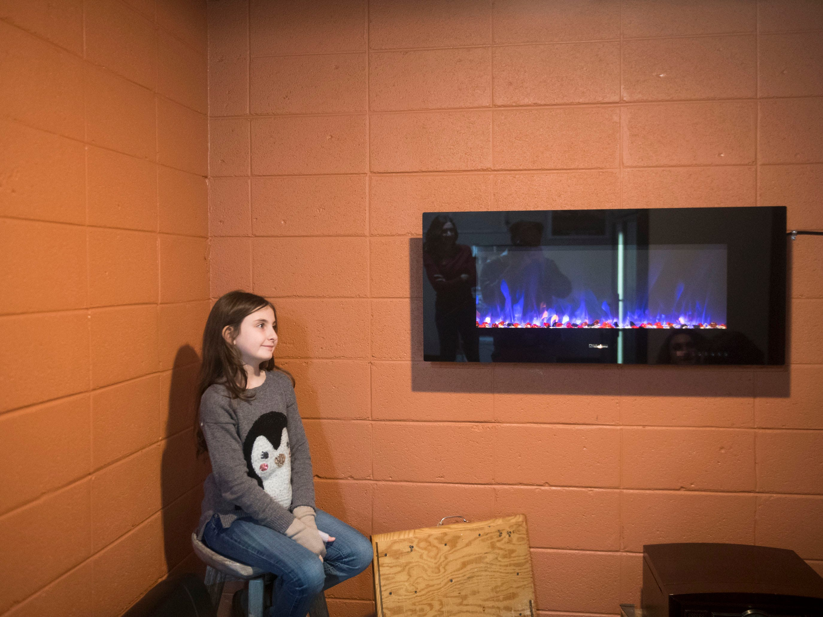 Abby Polsky sits in the lounge area of her mother, Lisa Henderson's, candy shop Gimme Sugar on Friday, December 21, 2018.