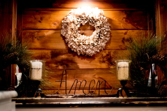 """""""Amen"""" reads a decoration inside the Greiner home."""