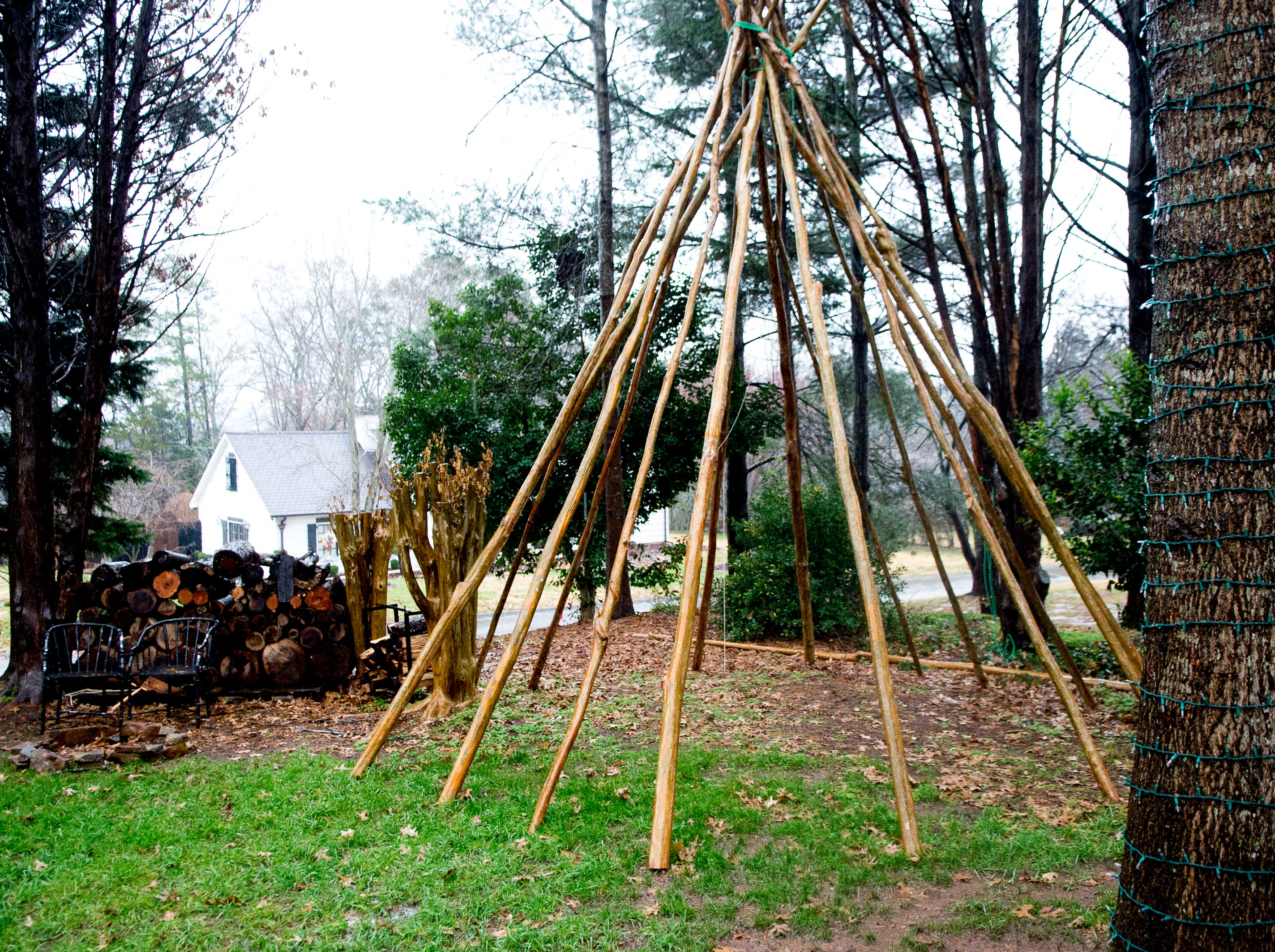 Matt Greiner built this tepee in the front yard with felled trees from the property at his family's home in West Knoxville.