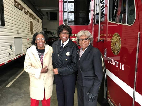 KFD Capt. Jaquetta Brooks stands between her aunt Beatrice Arnett (left) and mother Alzora Rader (right) during a ceremony celebrating her 30-year career with KFD.