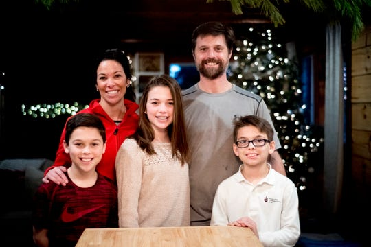 From left, 11-year-old Baylor, mom Lydia, 13-year-old Olivia, dad Matt, and 9-year-old Waylon Greiner pose for a family photo inside their home on Breezy Ridge Trail in West Knoxville.