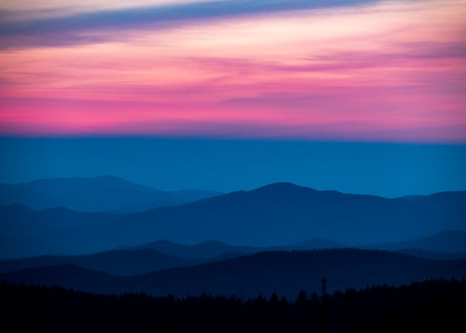 Shades of pink and blue fill the sky as the sun sets over the Smoky Mountains at Clingmans Dome in the Great Smoky Mountains National Park on May 12, 2018.
