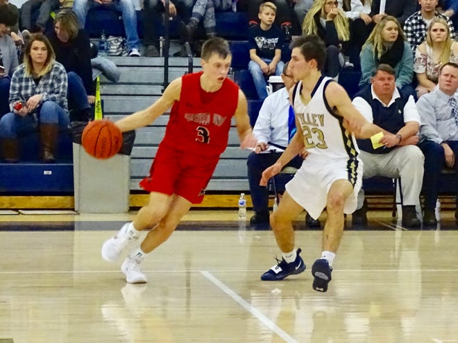 Fairfield Union sophomore Ryan Magill dribbles past Teays Valley's Riely Weiss during Saturday's Mid-State League-Buckeye Division game. The Falcons won, 50-39.