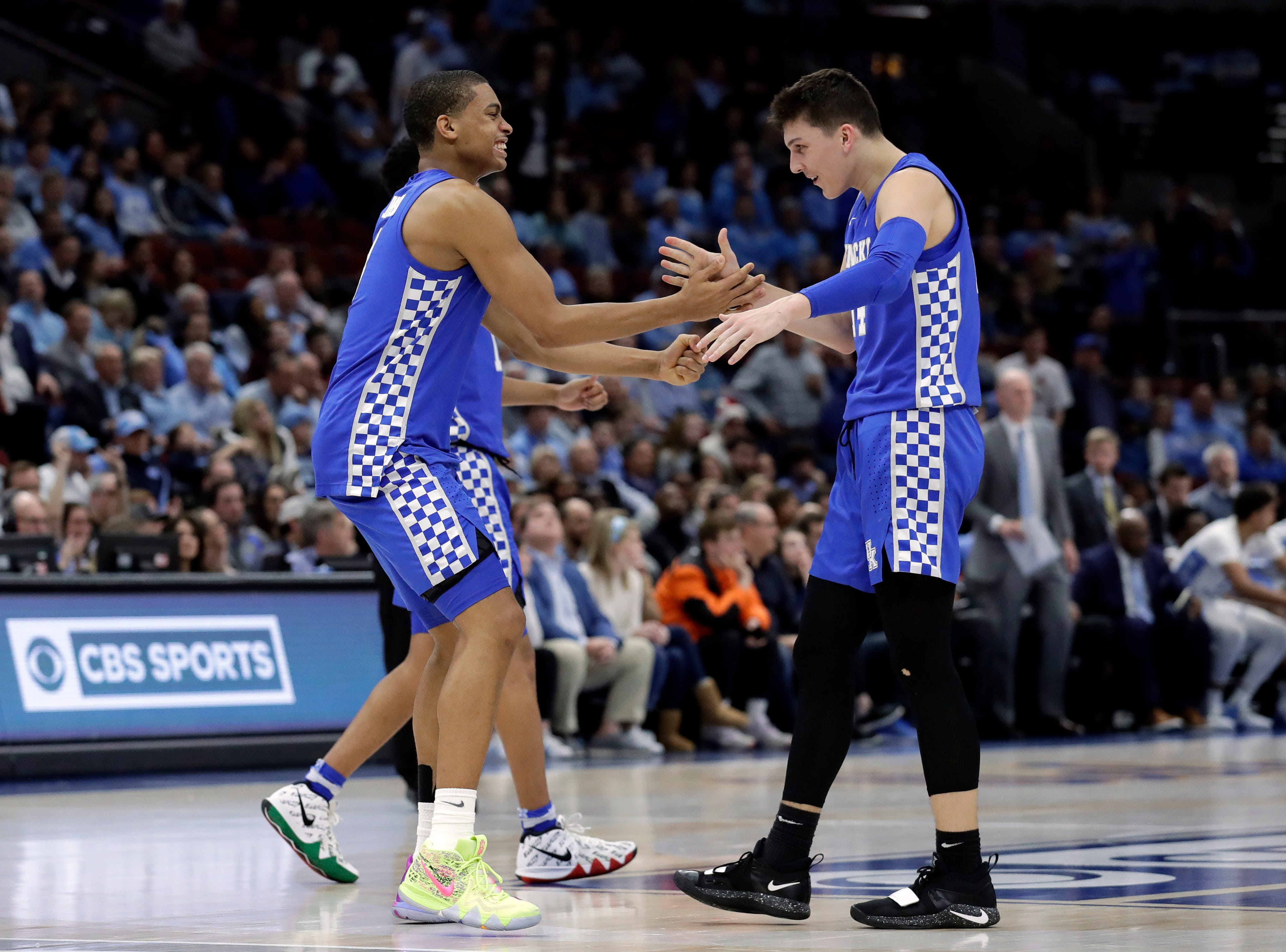 Kentucky guard Keldon Johnson, left, celebrates with guard/forward Tyler Herro during the second half of an NCAA college basketball game against North Carolina in the fifth annual CBS Sports Classic, Saturday, Dec. 22, 2018, in Chicago.