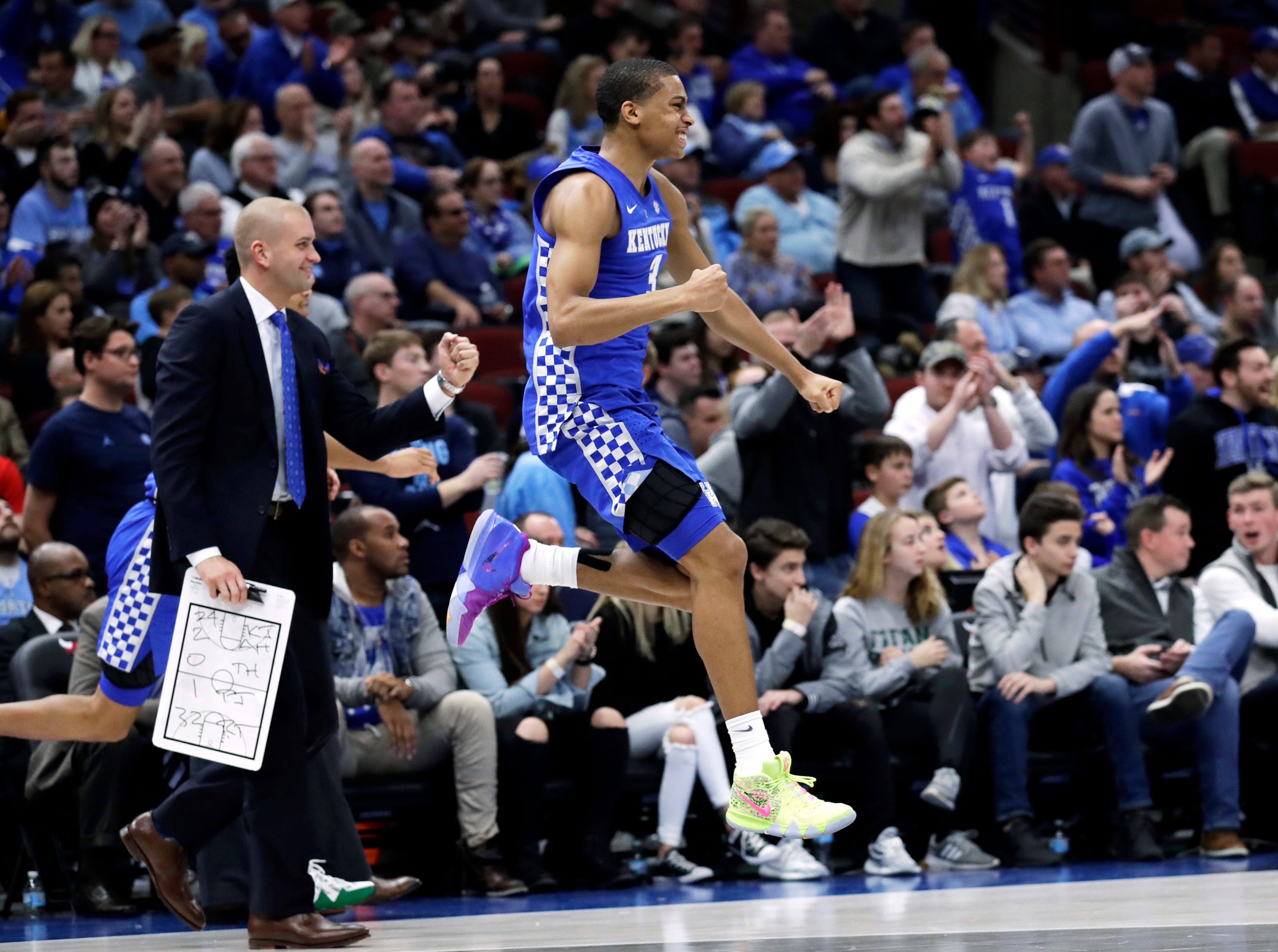 Kentucky guard Keldon Johnson jumps as he celebrates during the second half of an NCAA college basketball game against North Carolina in the fifth annual CBS Sports Classic, Saturday, Dec. 22, 2018, in Chicago. Kentucky won 80-72.