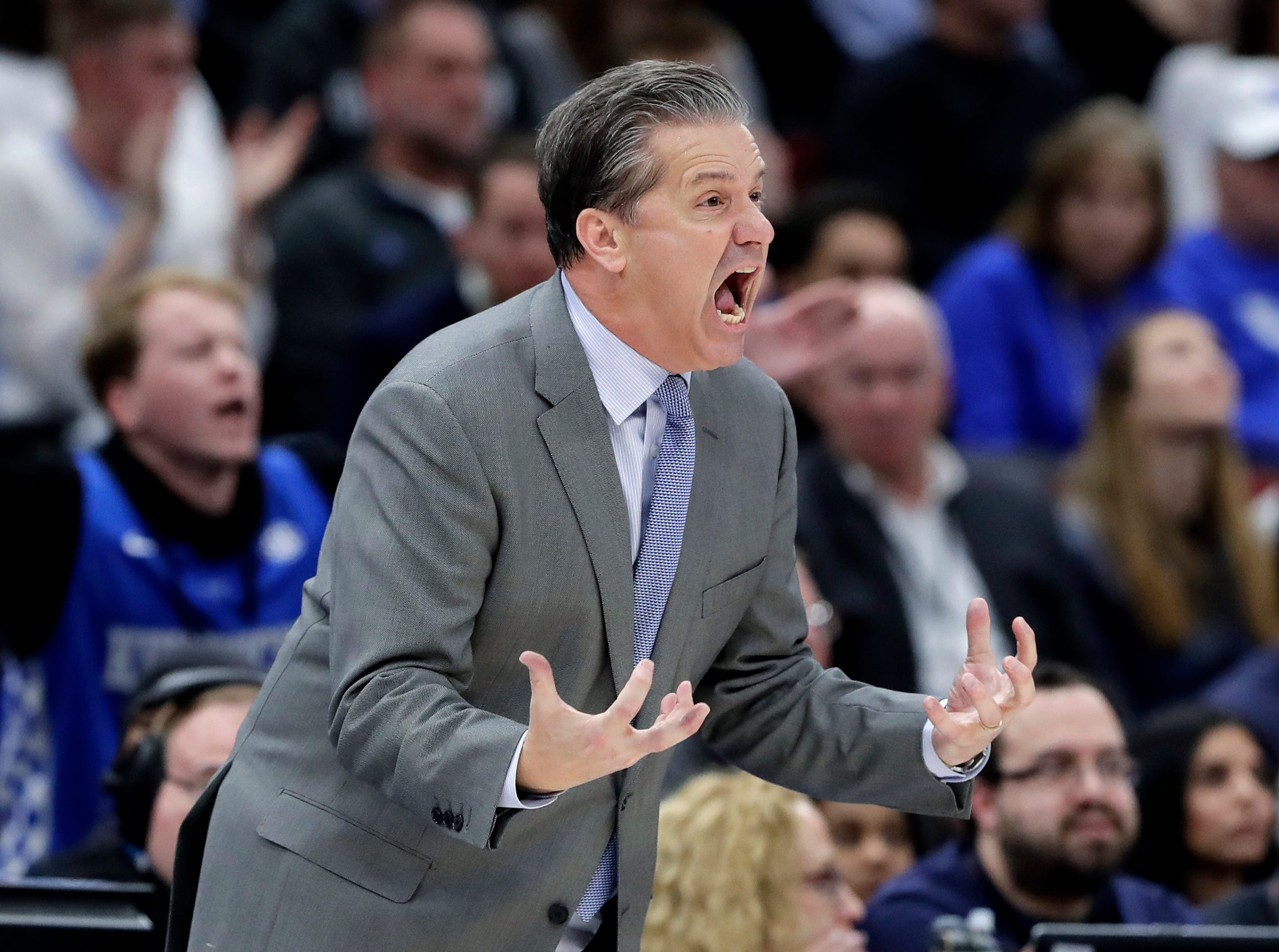 Kentucky coach John Calipari reacts to a call during the second half of the team's NCAA college basketball game against North Carolina on Saturday, Dec. 22, 2018, in Chicago. Kentucky won 80-72.