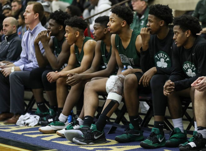 Trinity's David Johnson sat out the second half due to injuring his left knee. He finished with 18 points. Dec. 22, 2018