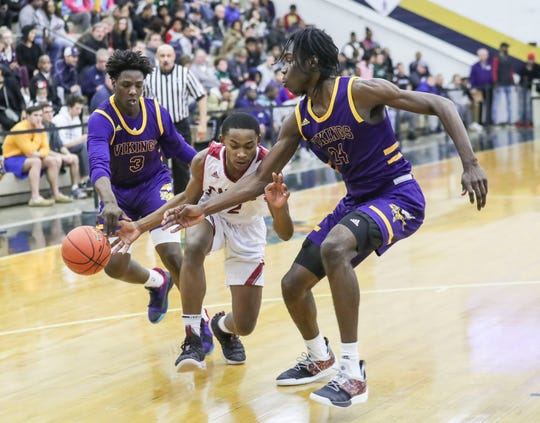 Brooklyn (N.Y.) South Shore High's Isaiah Richards, right, pressures Ballard High's Isaac Womack during a December 2018 game played in Kentucky.