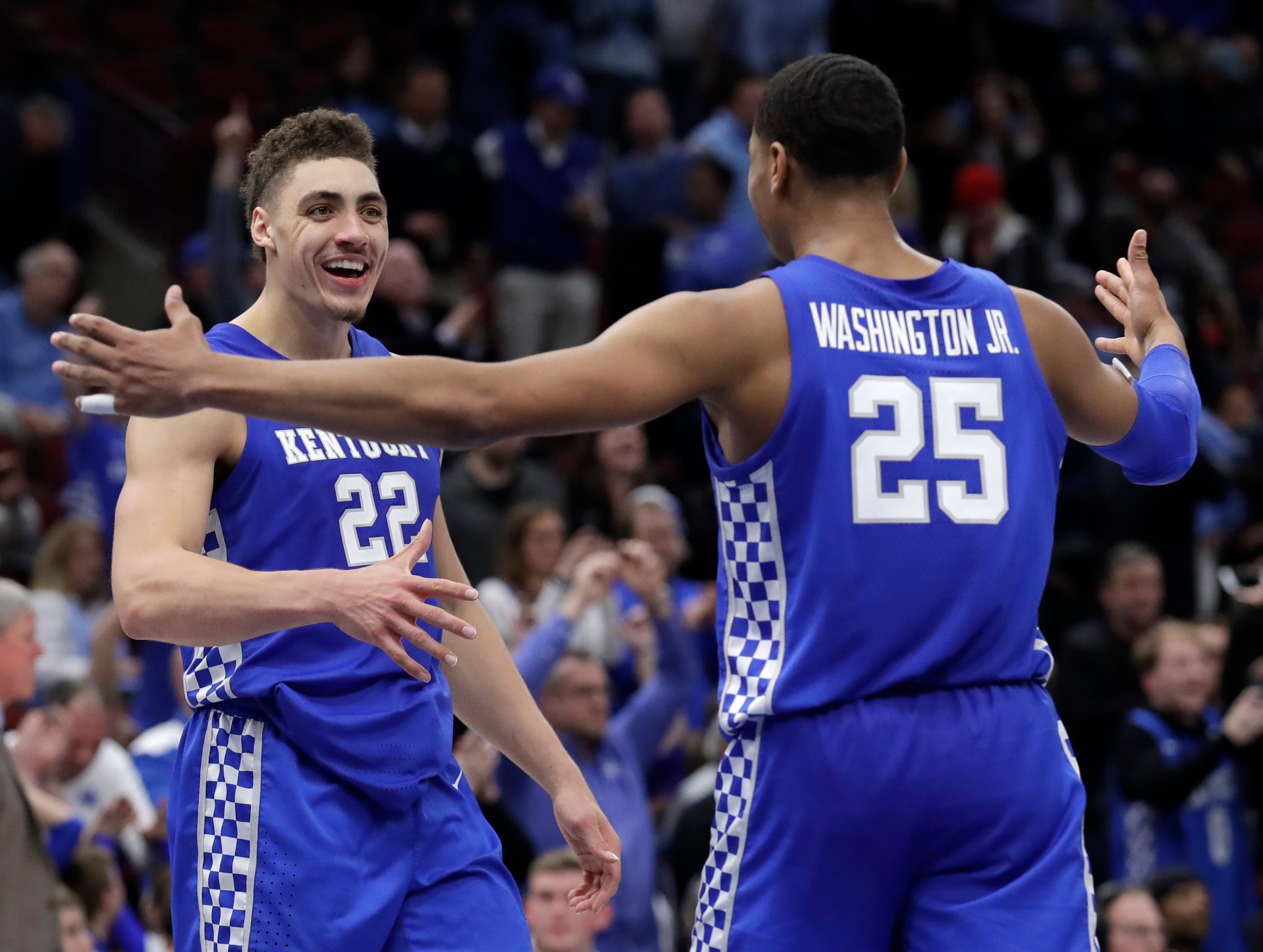 Kentucky forward Reid Travis, left, celebrates with forward PJ Washington Jr., after their team defeated North Carolina in an NCAA college basketball game in the fifth annual CBS Sports Classic, Saturday, Dec. 22, 2018, in Chicago.