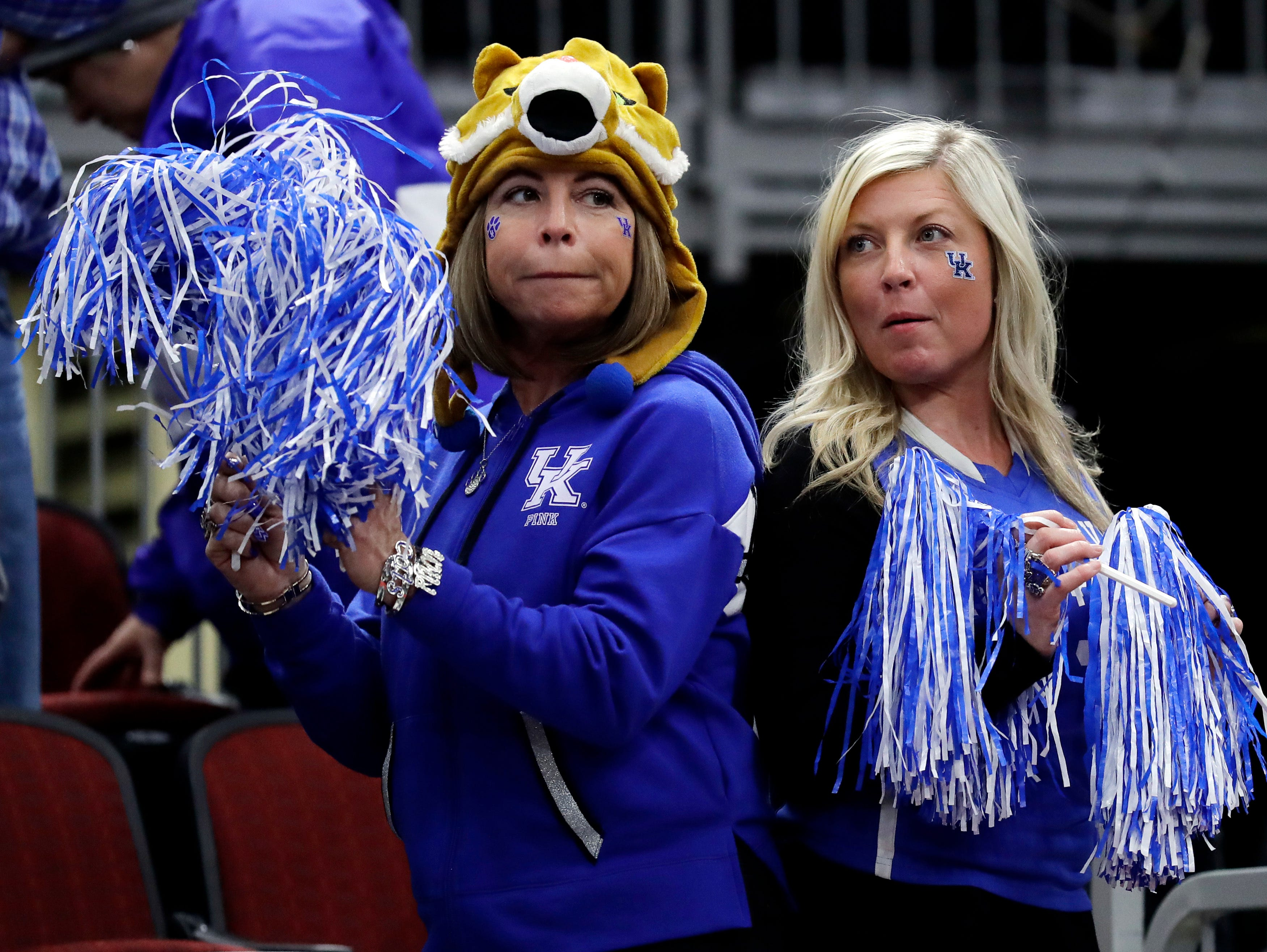 Kentucky fans cheer for their team during the second half of an NCAA college basketball game against North Carolina in the fifth annual CBS Sports Classic, Saturday, Dec. 22, 2018, in Chicago.