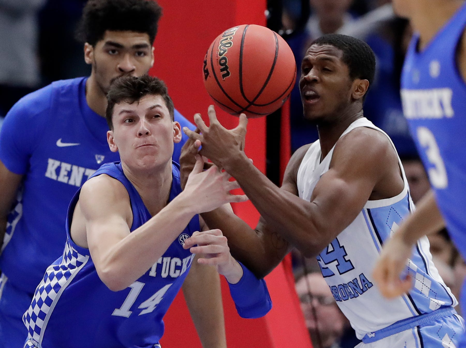 Kentucky guard/forward Tyler Herro, left, and North Carolina guard Kenny Williams battle for the ball during the second half of an NCAA college basketball game in the fifth annual CBS Sports Classic, Saturday, Dec. 22, 2018, in Chicago.
