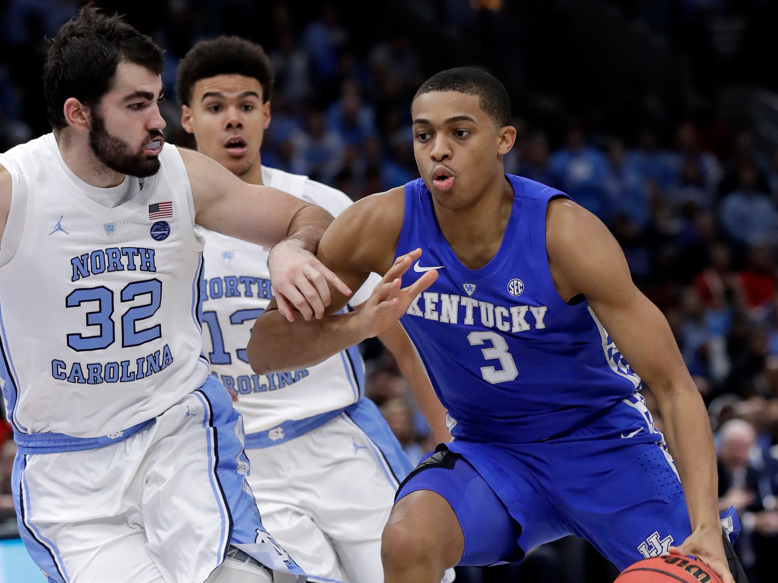 Kentucky guard Keldon Johnson, right, drives against North Carolina forward Luke Maye during the second half of an NCAA college basketball game in the fifth annual CBS Sports Classic, Saturday, Dec. 22, 2018, in Chicago.