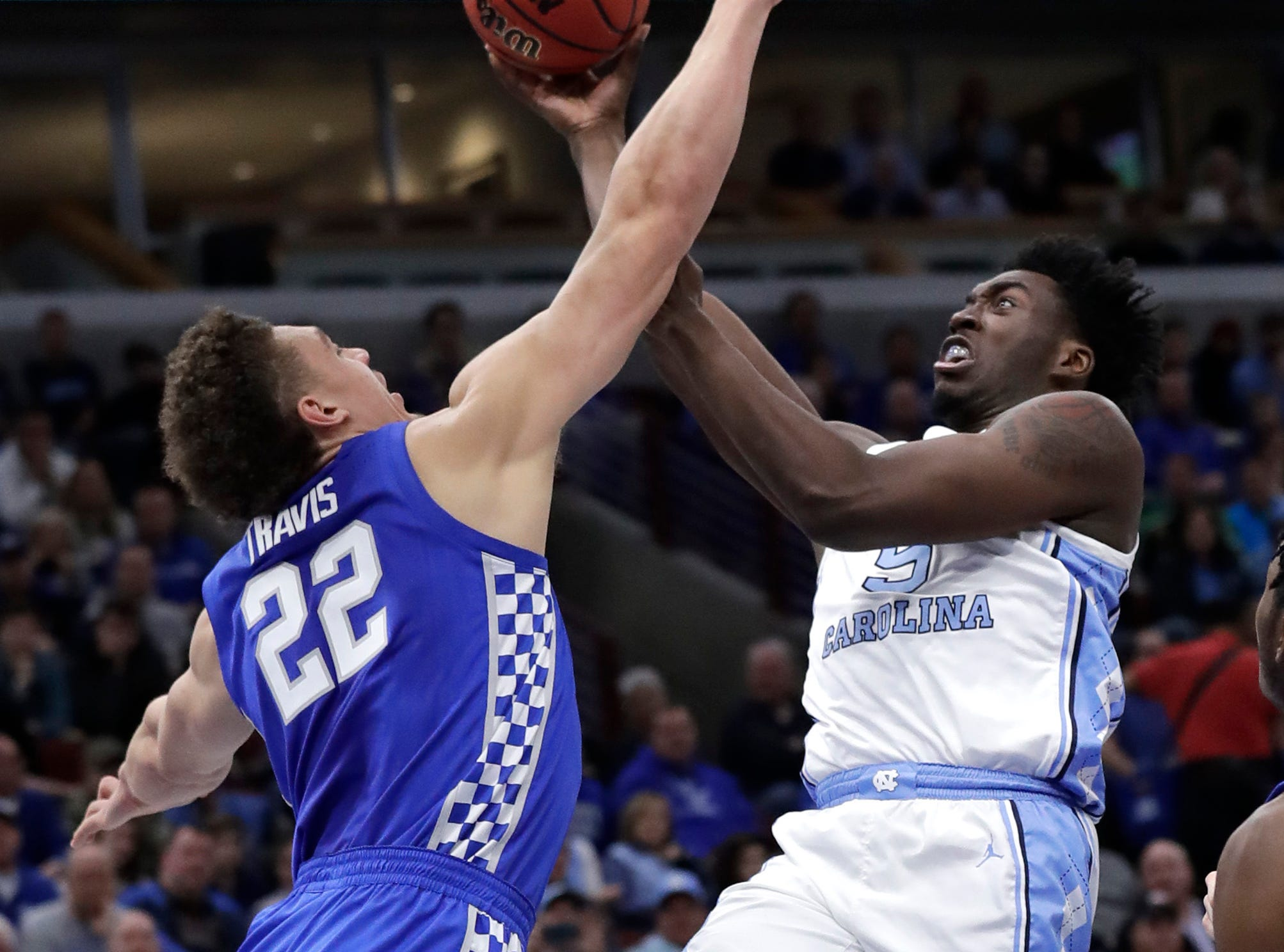 North Carolina forward Nassir Little, right, shoots against Kentucky forward Reid Travis during the first half of an NCAA college basketball game in the fifth annual CBS Sports Classic, Saturday, Dec. 22, 2018, in Chicago. Kentucky won 80-72.