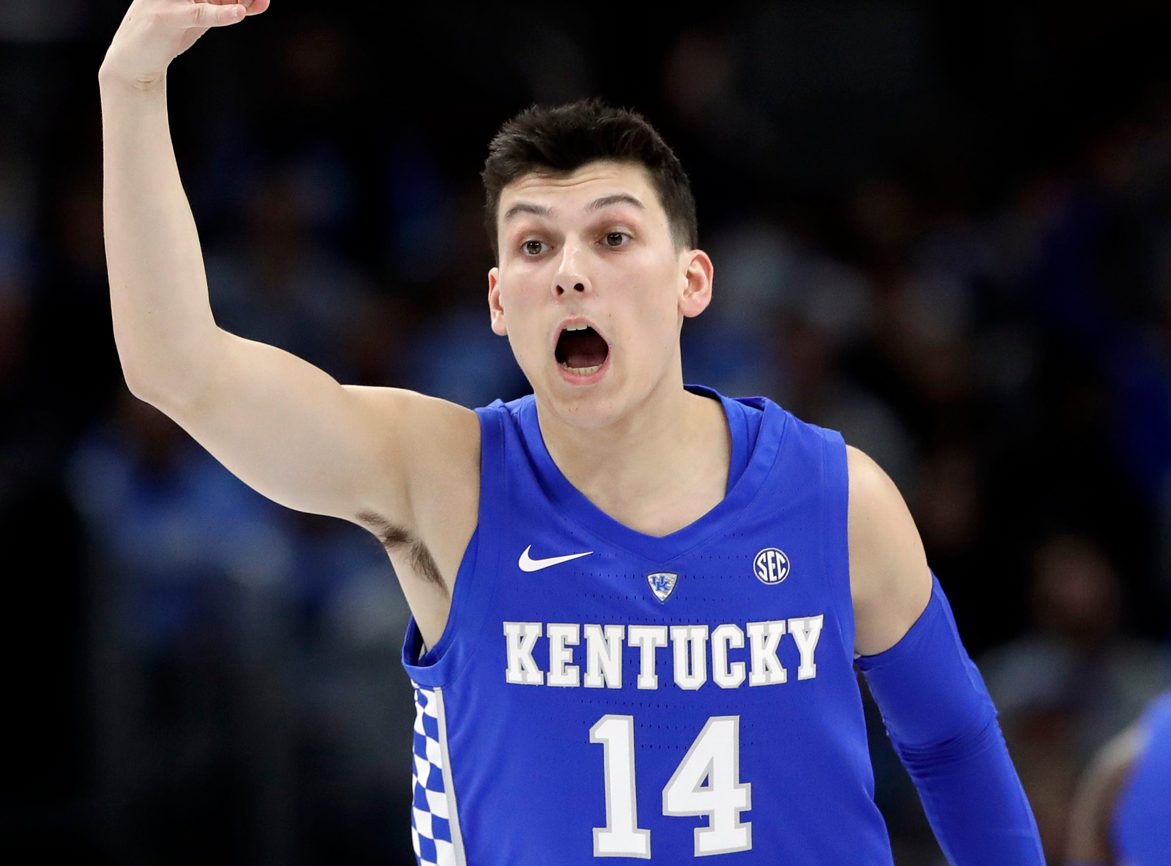 Kentucky guard/forward Tyler Herro reacts after he made a three-point basket against North Carolina during the first half of an NCAA college basketball game in the fifth annual CBS Sports Classic, Saturday, Dec. 22, 2018, in Chicago.