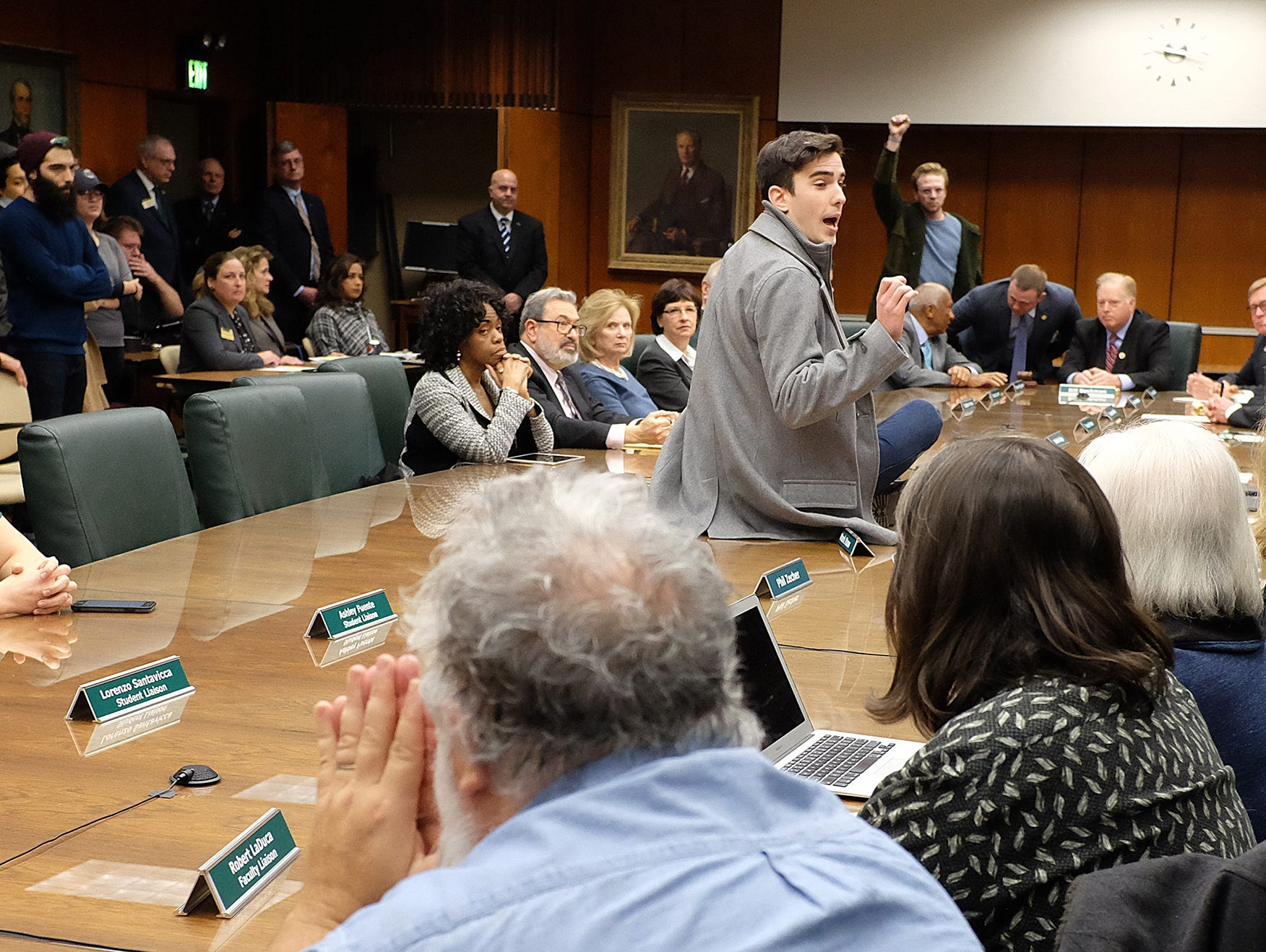 MSU senior Connor Berdy protests at the MSU Board of Trustees meeting Wednesday, Jan. 31, 2018 in East Lansing, Michigan.