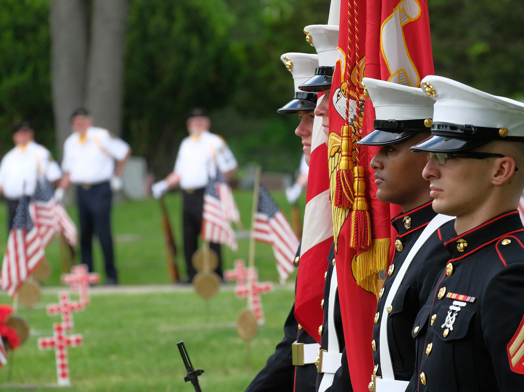A U.S. Marine Corps Color Guard performs its duties at a Memorial Day ceremony at Evergreen Cemetery in Lansing on Saturday, May 26, 2018.