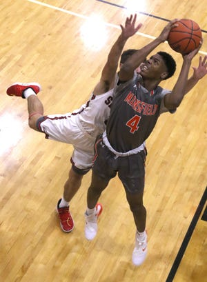 Mansfield Senior's Dontavious Burtin attempts a shot during Saturday's game against Shelby as part of the quadruple-header 419 Challenge at Ontario High School.