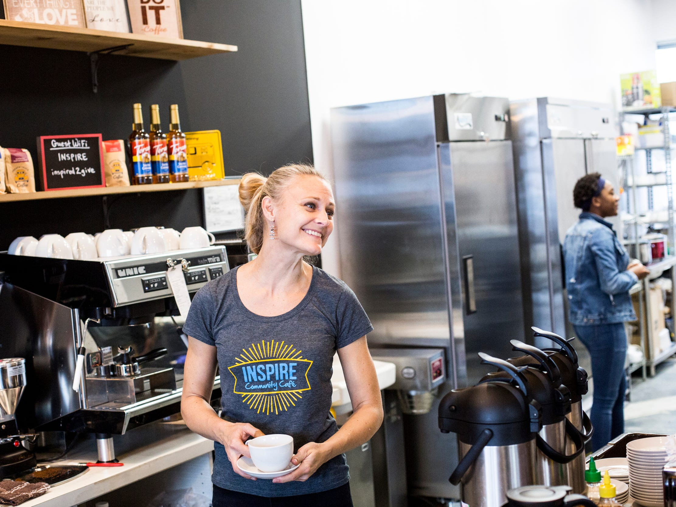 "December 23 2018 - Kristin Fox-Trautman, owner of Inspire Community Cafe, smiles while fixing up a drink during the final of three friends & family soft openings before the cafe opens January 4th. ""Our mission is to nourish community change,"" Fox-Trautman said of the cafe."