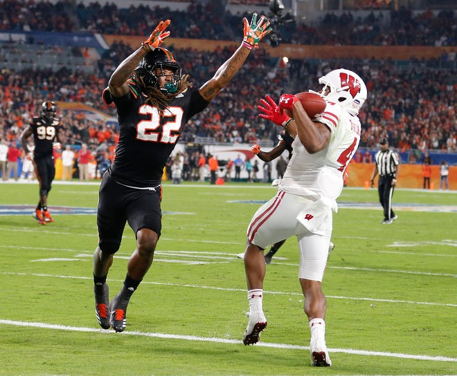 Miami cornerback Sheldrick Redwine (left) struggled against A.J. Taylor and the Badgers offense in the Orange Bowl last season but has three interceptions this year.