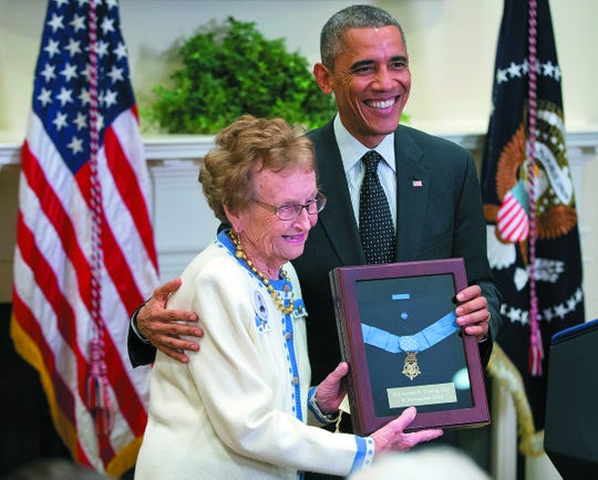 President Barack Obama stands with Helen Loring Ensign, 85, from Palm Desert, Calif., as he awards the Medal of Honor posthumously to Army First Lt. Alonzo H. Cushing for conspicuous gallantry, Thursday, Nov. 6, 2014, during a ceremony in the East Room of the White House in Washington. Obama bestowed the nation's highest military honor to the Union Officer who was killed more the 150 years ago in the Battle of Gettysburg. Cushing died in July 1863 while standing his ground against Pickett's Charge. Ensign is related to Cushing through Cushing's mother and is his first cousin twice removed.  (AP Photo/Pablo Martinez Monsivais) ORG XMIT: DCPM101