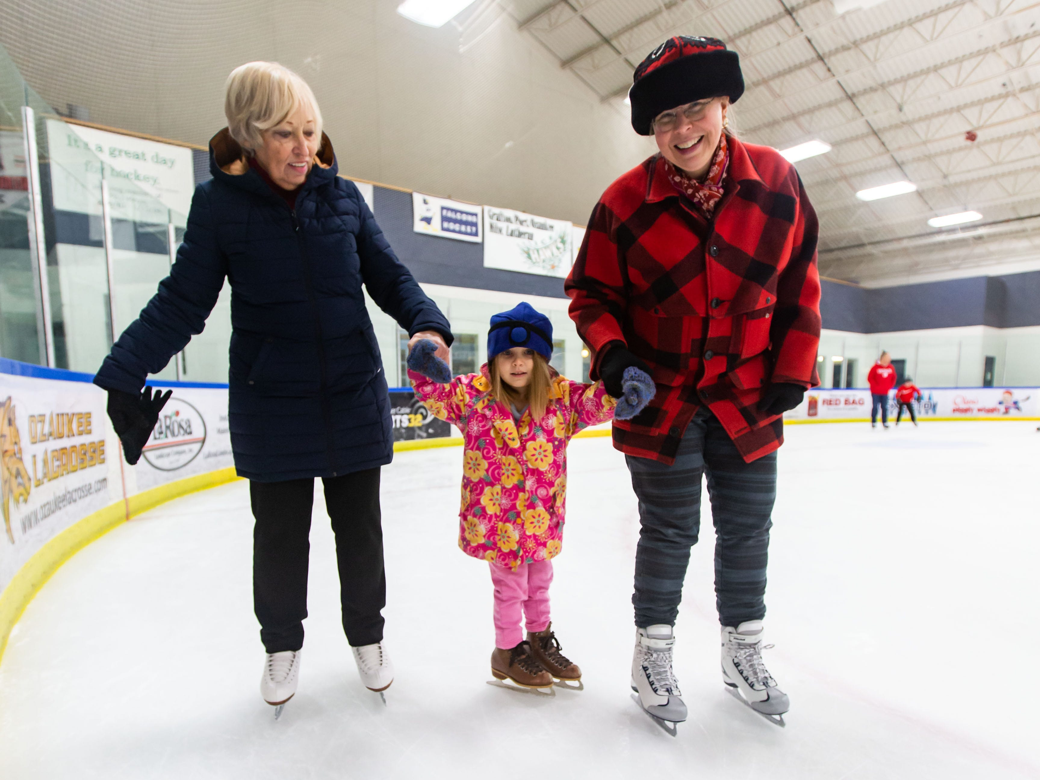 Instructor Lillian Habeck (left) skates with four-year-old Lillywolf Meltzer and her mother Katie of Mequon during public skating hours at the Ozaukee Ice Center in Mequon on Saturday, Dec. 22, 2018.