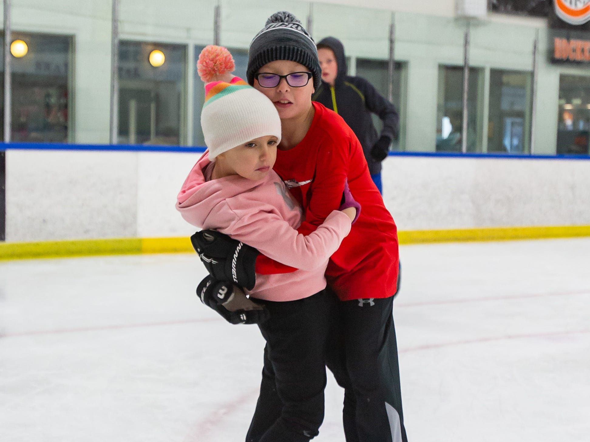 Dominic LaRosa, 9, of Cedarburg steadies his sister Gianna, 7, as they enjoy the public skating hours at the Ozaukee Ice Center in Mequon on Saturday, Dec. 22, 2018.