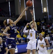 Notre Dame  forward Brianna Turner  tips away a shot by Marquette's Natisha Hiedeman.