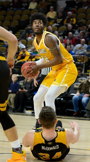 Vance Johnson (shown in an earlier game) scored the last four points on Saturday to cap a UW-Milwaukee comeback.
