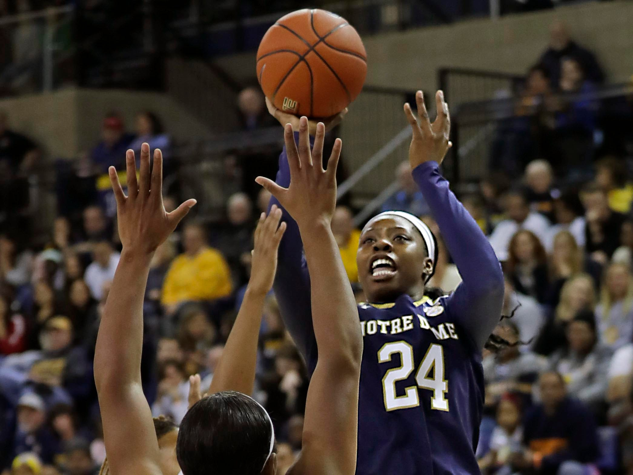 Notre Dame Fighting Irish guard Arike Ogunbowale  hits a jumper over Marquette Golden Eagles forward Erika Davenport.
