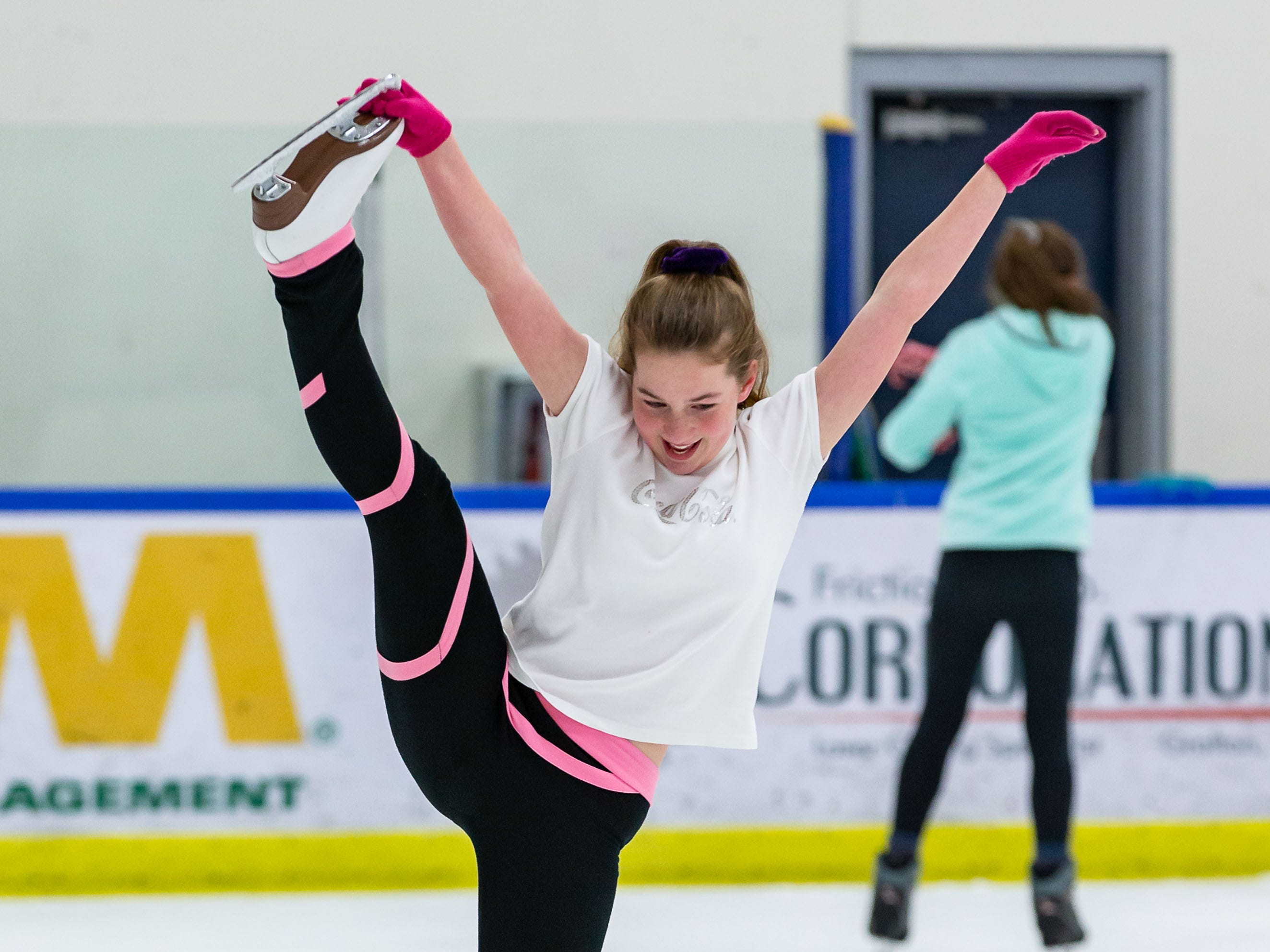 Figure skater Bianca Nichols, 14, of Germantown performs a Y-spiral while practicing at the Ozaukee Ice Center in Mequon during public skating hours on Saturday, Dec. 22, 2018. The center offers public skating between 12:15 p.m. and 2:15 p.m. on Saturdays and Sundays.