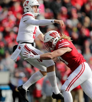Because of his size Andrew Van Ginkel (right) might be the best pro prospect among UW's trio of senior linebackers.