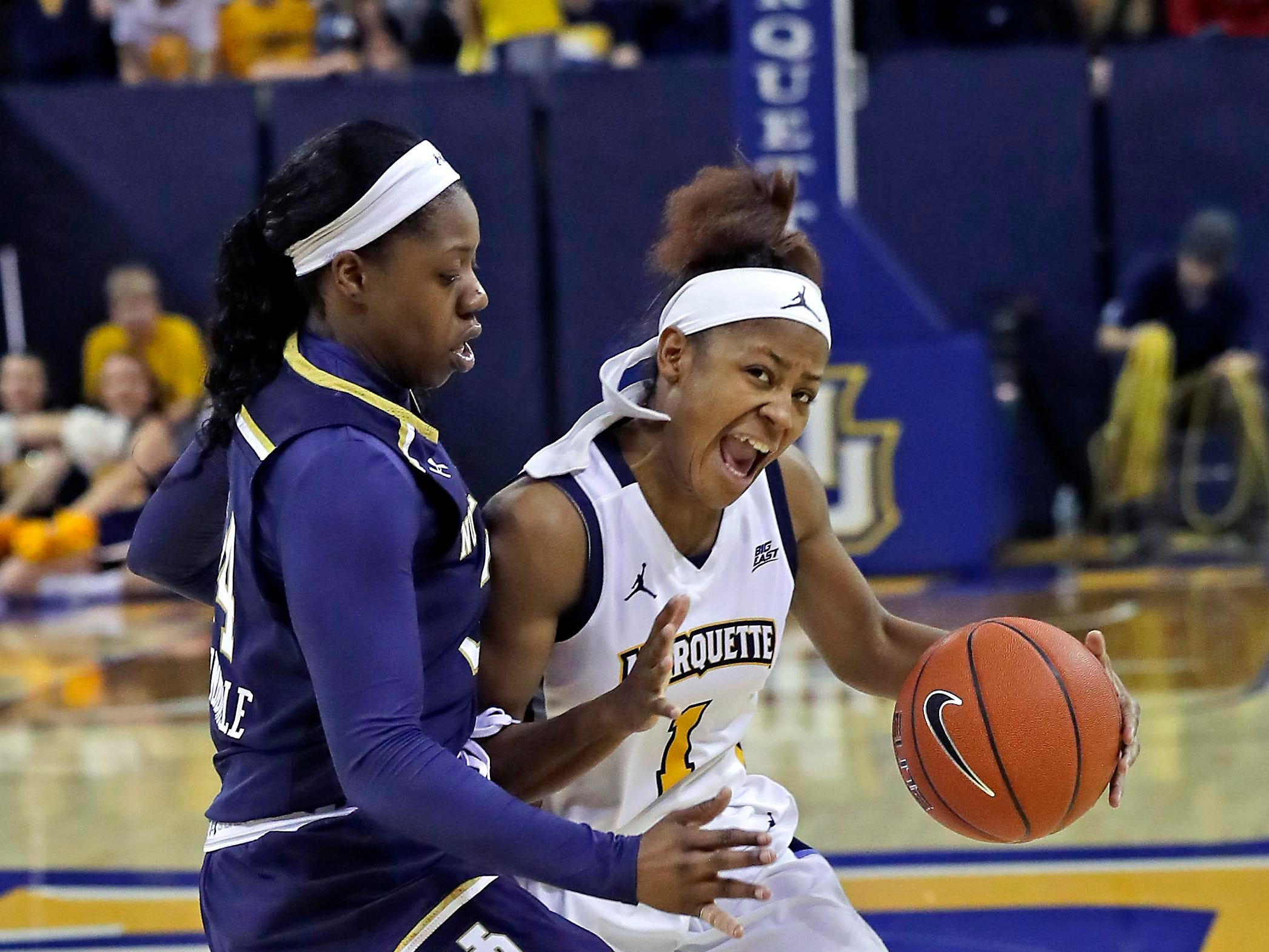 Marquette guard Danielle King  is pressured by Notre Dame guard Arike Ogunbowale.