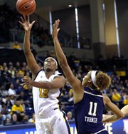 Ericka Davenport (shown in an earlier game) scored 24 points and grabbed 13 rebounds on Friday night at St. John's.