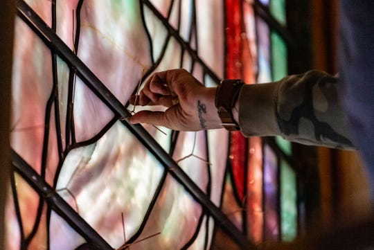 A worker from Oakbrook Esser Studios in Oconomowoc installs a stained glass window at Immanuel Presbyterian Church in Milwaukee on Friday, Dec. 21, 2018. Oakbrook Esser Studios restored the window which was originally designed by Tiffany Studios and installed at Immanuel in 1903.