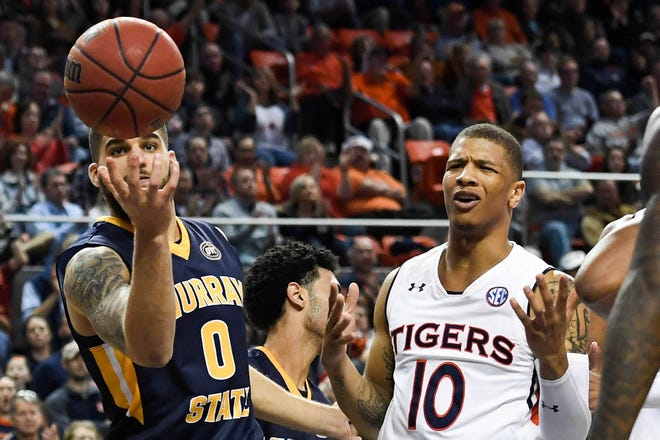 Murray State forward Mike Davis (0) goes for a rebound as Auburn Tigers guard Samir Doughty (10) reacts during the second half at Auburn Arena on Dec. 22, 2018, in Auburn, Ala.