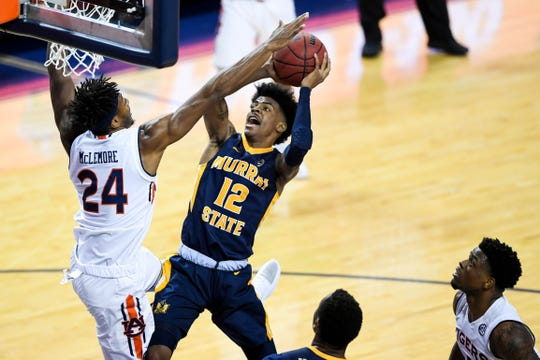 Murray State guard Ja Morant (12) is defended by Auburn forward Anfernee McLemore (24) on Dec. 22, 2018, in Auburn, Ala.