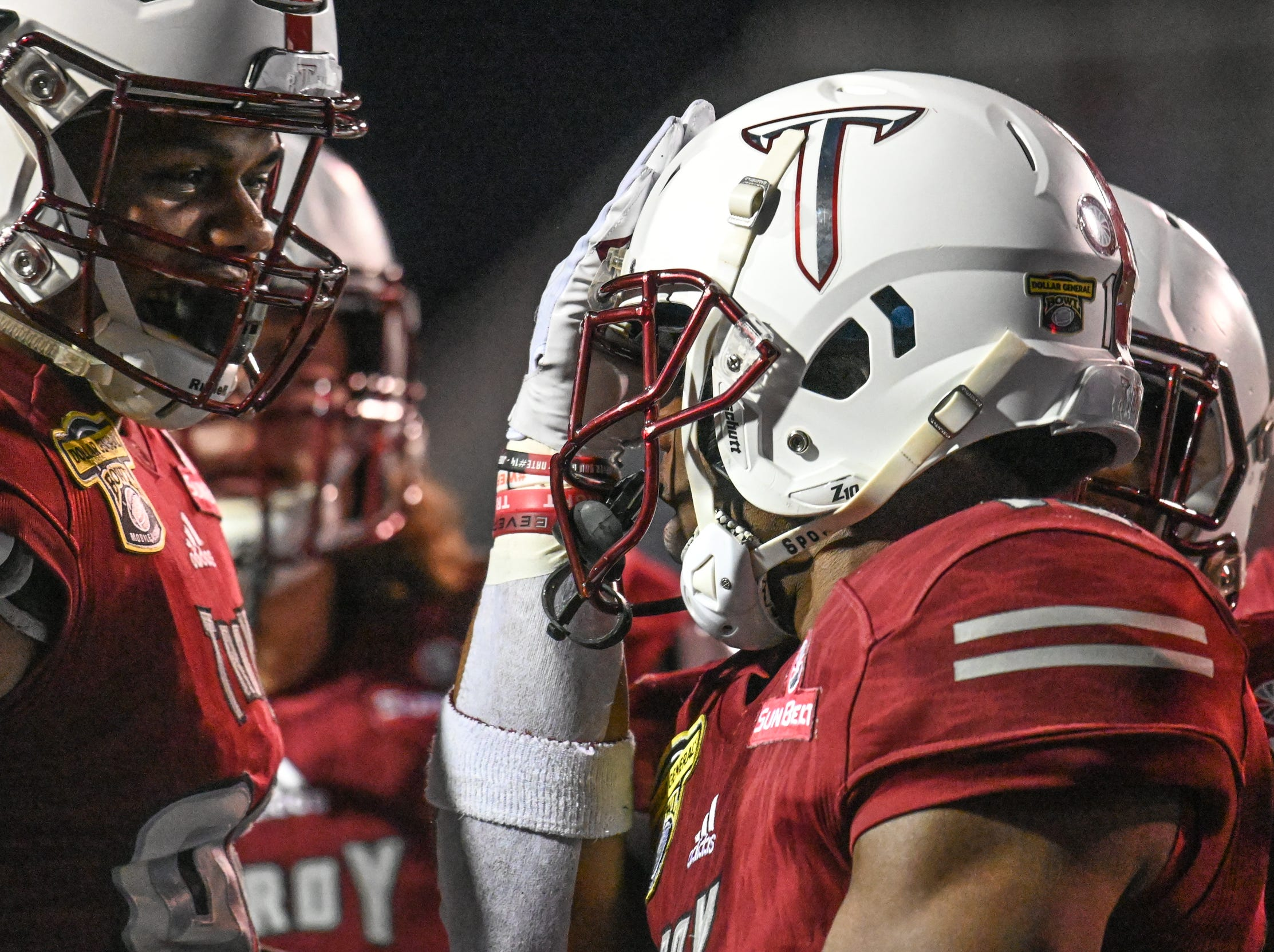 The Troy offense celebrates a first quarter touchdown against Buffalo during the Dollar General Bowl held at Ladd-Peebles Stadium in Mobile on Saturday, Dec. 22, 2018.