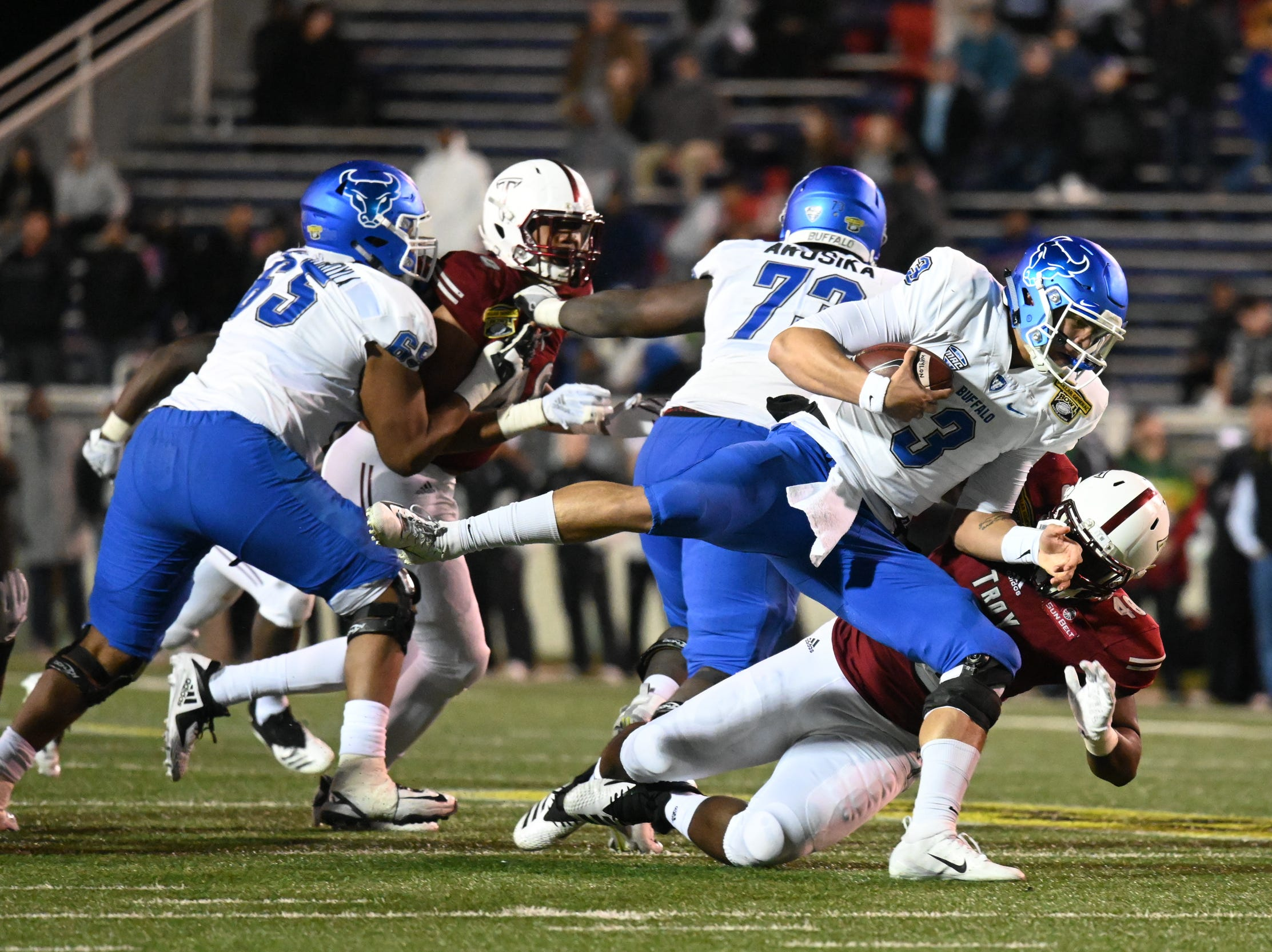 Buffalo Bulls quarterback Tyree Jackson (3) is sacked by Troy defensive tackle Antione Barker (40) during the second half of the Dollar General Bowl held at Ladd-Peebles Stadium in Mobile on Saturday, Dec. 22, 2018.