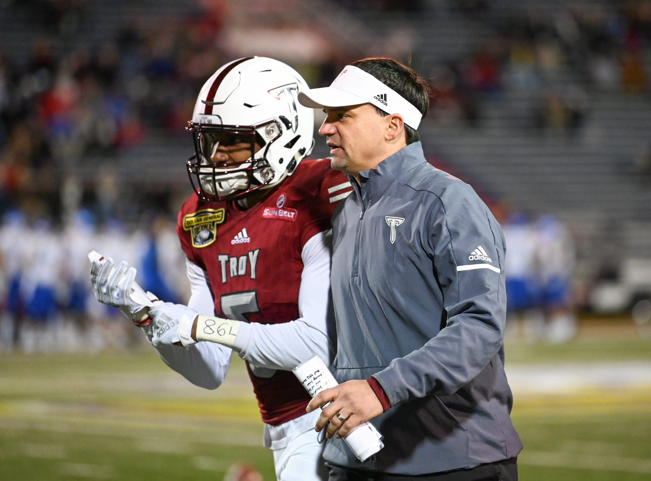 Troy head coach Neal Brown talks with Troy Trojans running back Jabir Daughtry-Frye (5) during the Dollar General Bowl held at Ladd-Peebles Stadium in Mobile on Saturday, Dec. 22, 2018.