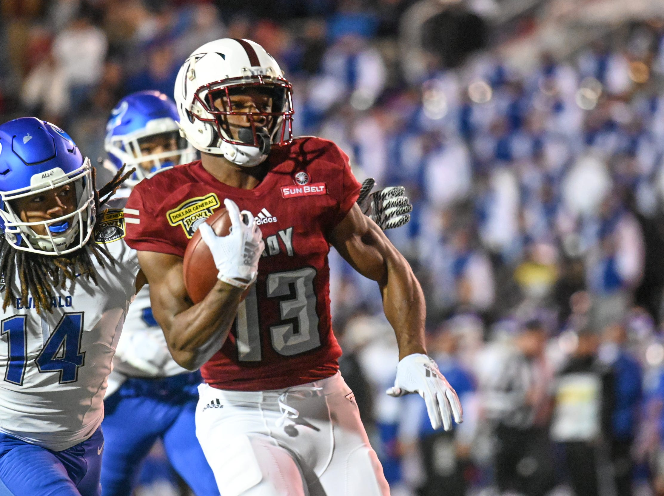 Troy Trojans wide receiver Tray Eafford (13) runs the ball into the end zone for a touchdown against Buffalo during the Dollar General Bowl held at Ladd-Peebles Stadium in Mobile on Saturday, Dec. 22, 2018.