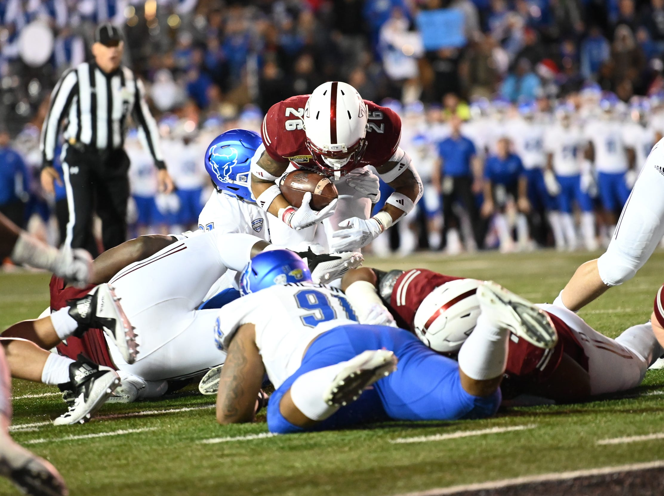 Troy Trojans running back B.J. Smith (26) goes over a pile of defenders during the Dollar General Bowl held at Ladd-Peebles Stadium in Mobile on Saturday, Dec. 22, 2018.