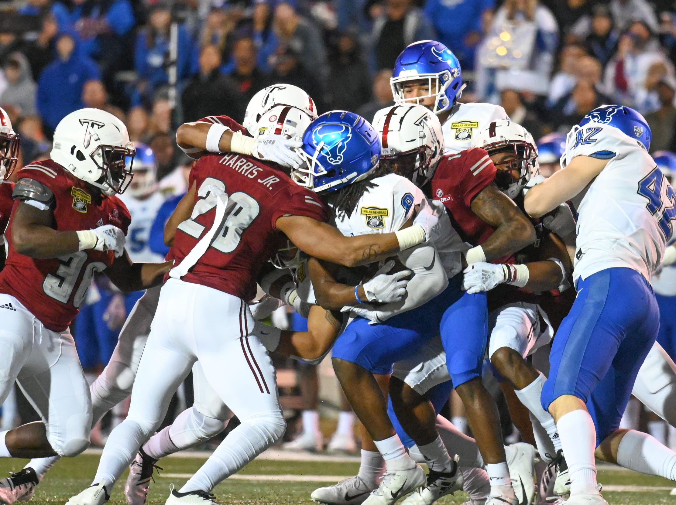 Buffalo Bulls wide receiver K.J. Osborn (8) is wrapped up by the Troy defense  during the Dollar General Bowl held at Ladd-Peebles Stadium in Mobile on Saturday, Dec. 22, 2018.