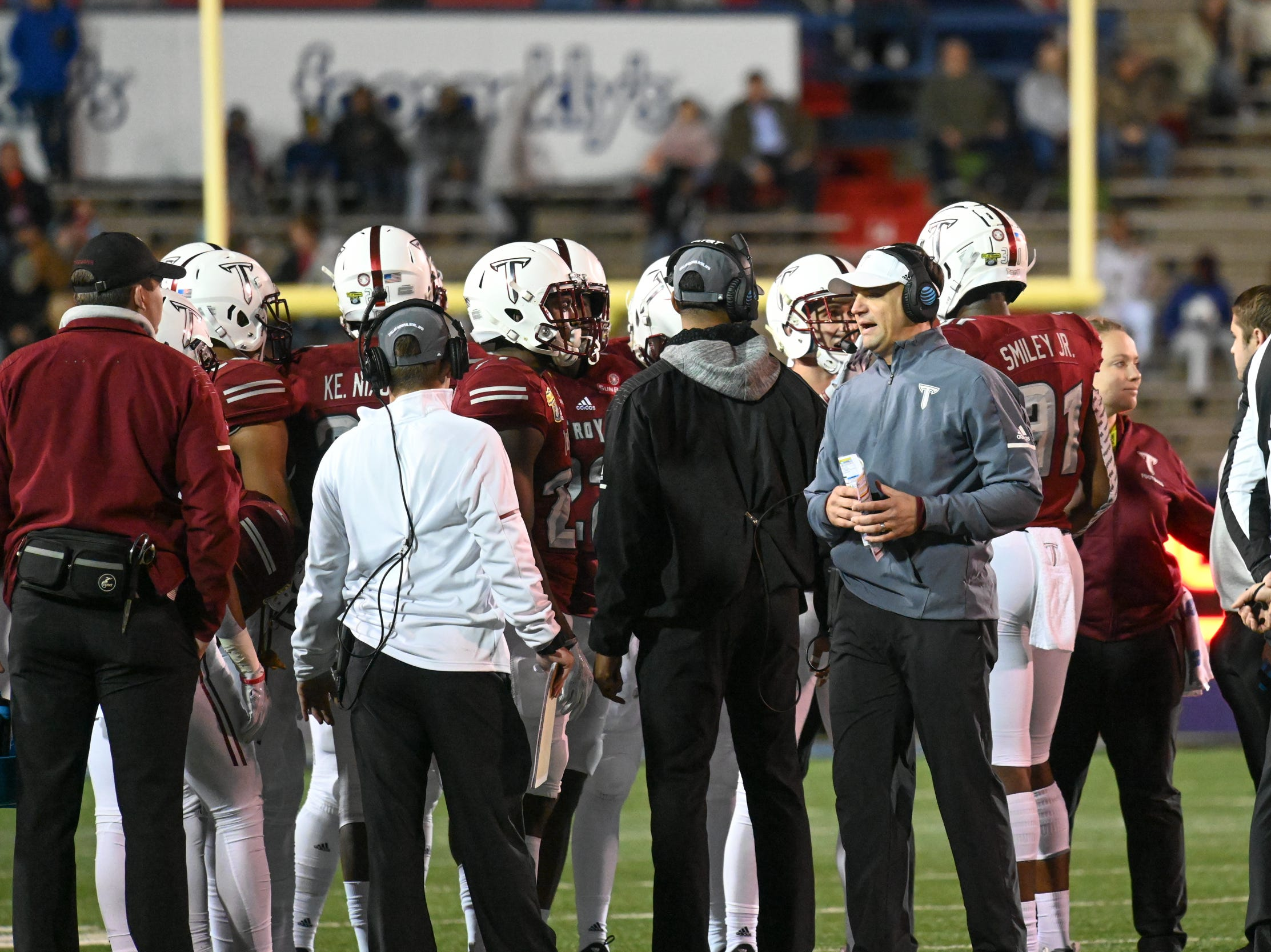 Troy head coach Neal Brown talks to the team during a timeout against Buffalo during the Dollar General Bowl held at Ladd-Peebles Stadium in Mobile on Saturday, Dec. 22, 2018.