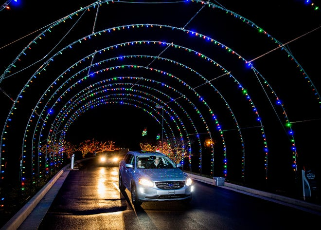 Visitors drive through the light display at the Suzanne Gresham Center in Muncie in 2018.