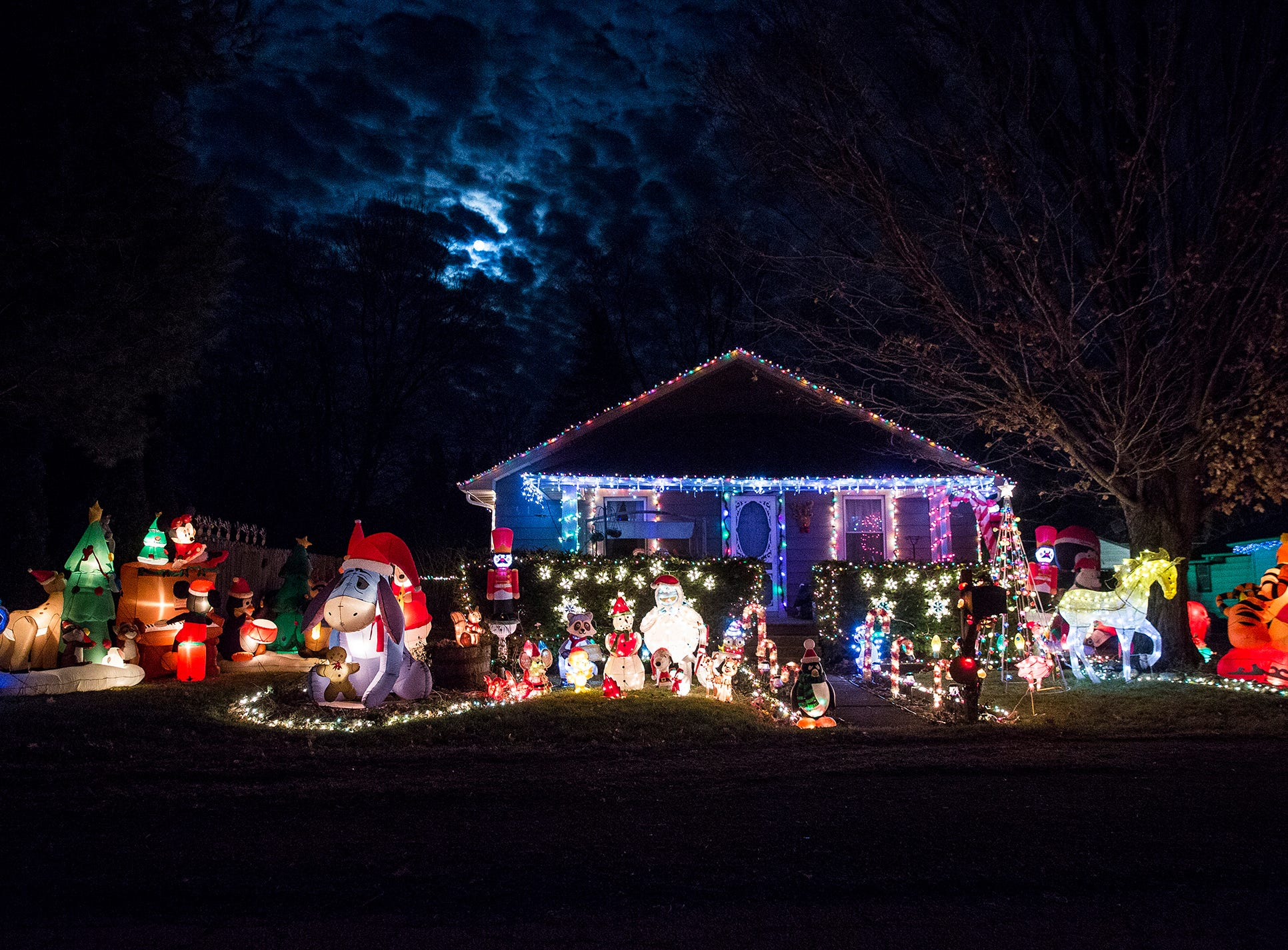 Christmas decorations light up a house on S. Ribble Street in Muncie.