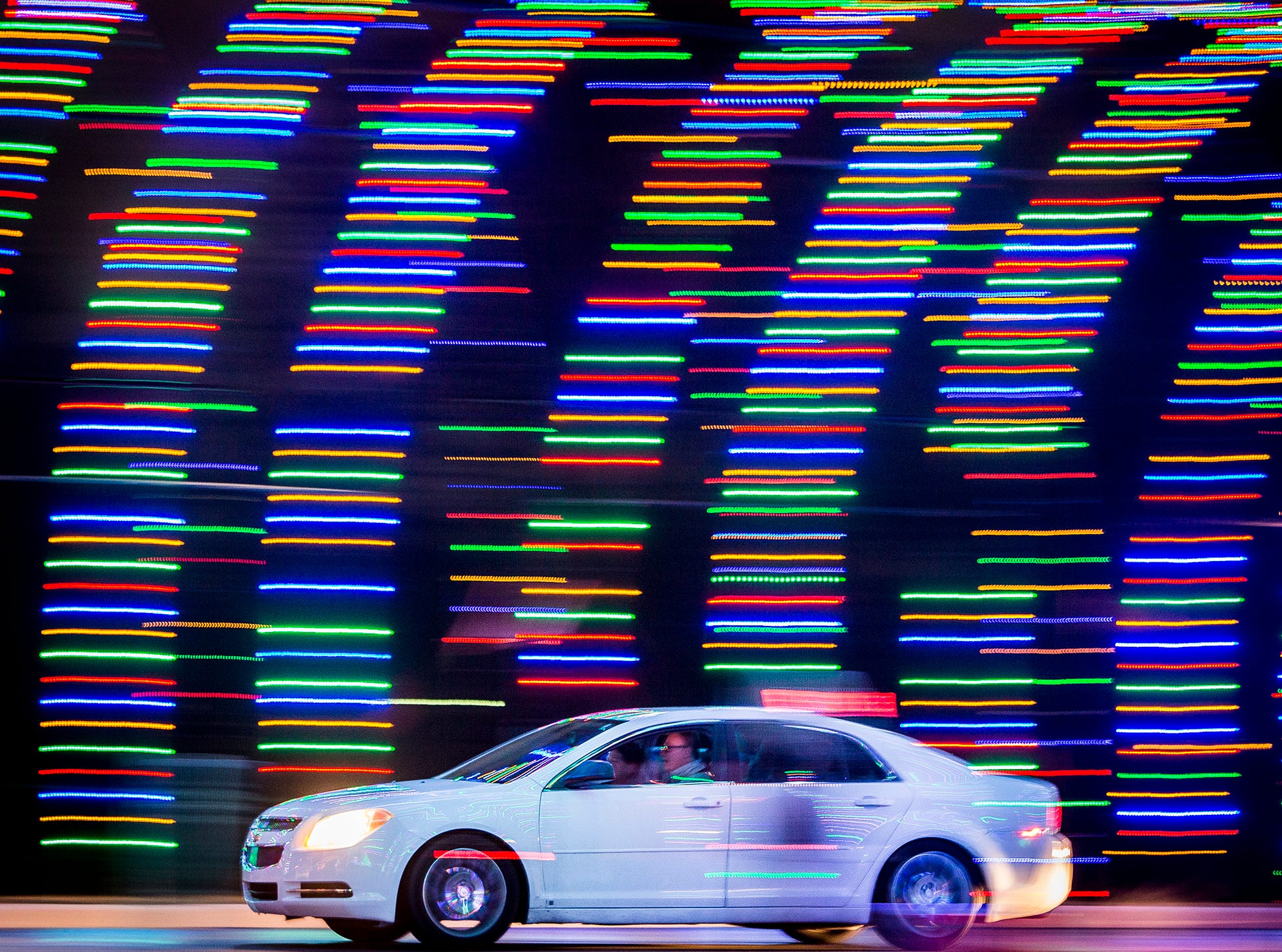 Visitors drive through the light display at the Suzanne Gresham Center in Muncie.