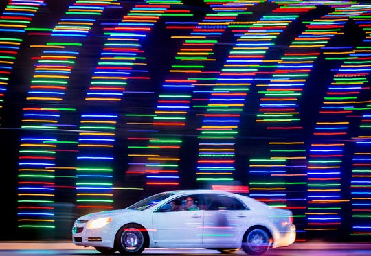 Visitors drive through the annual display of holiday lights at the Suzanne Gresham Center in 2018.